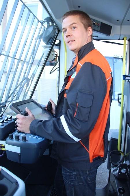 Mika Väisänen standing at the control panel