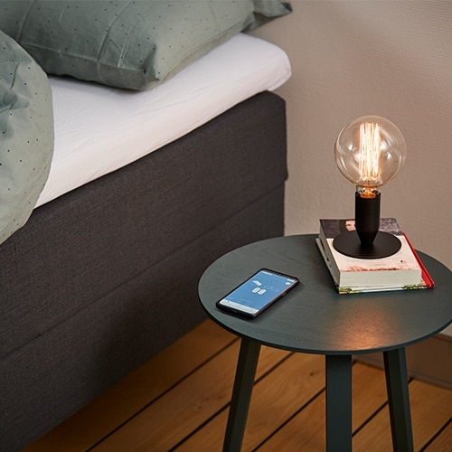 Bed Control App on night stand