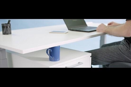 Biurko z regulacją elektryczną, chronione za pomocą technologii Anti-Collision