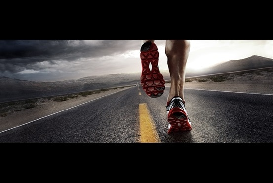 Close-up of feet of athletic man running long distance