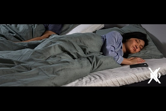 Enjoy a comfort bed with a silent alarm feature